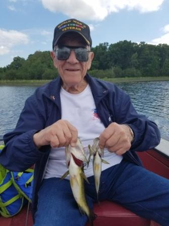 George C. somehow managed to catch 2 bass simultaneously on a worm rigged with a single octopus hook.  Very, very unusual.  June 2018.