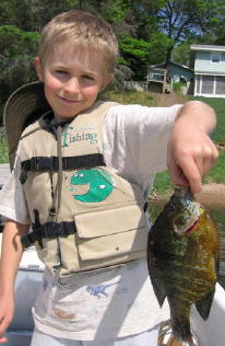 Ben with a 9 inch pumpkinseed he caught and released on Benoit Lake in May 19, 2007.  It was the resort record for more than 2 years.