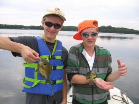 Ben C. and Jake K. caught these panfish using nightcrawler pieces and bobbers in water 4 feet deep; June 7, 2012.