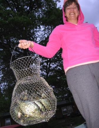 Carolyn B with a basket full of Benoit crappies, spring 2008.