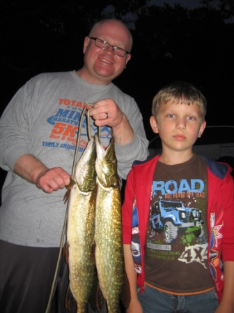 Dave and Donavan R. with a pair of nice pike caught in Rainbow Bay of Benoit Lake.  They were fishing over weeds.  Good job guys!  June 18, 2012.