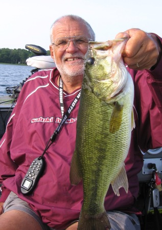Dave R caught and released this bass on a nearby lake.  He was fishing along the deep weed line.  July 2, 2012.
