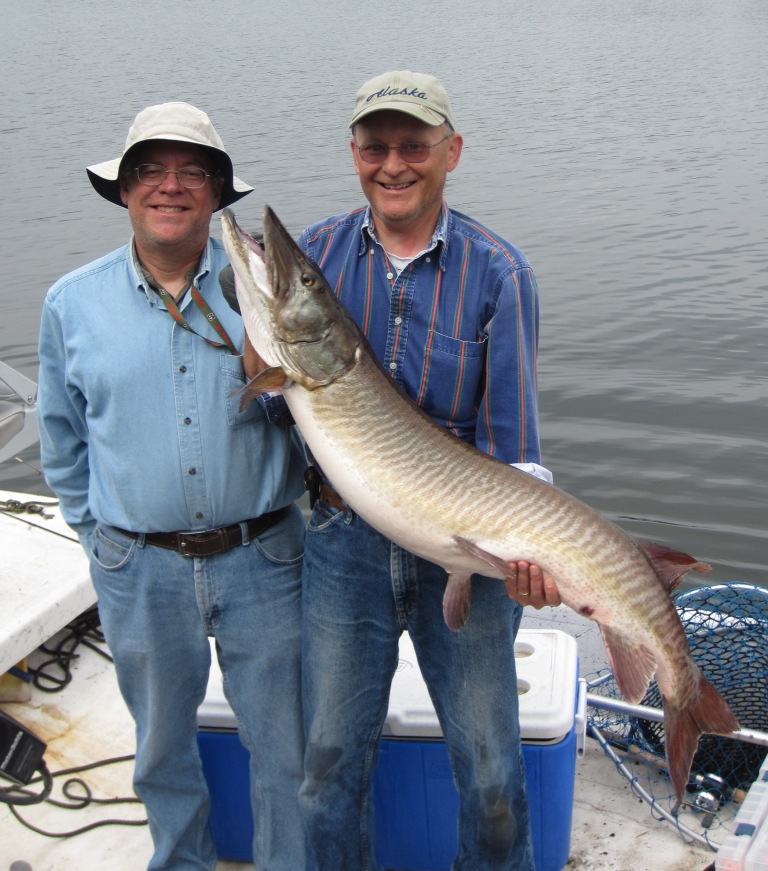 I caught this 51-inch musky on Benoit Lake on May 27, 2012.  Bryan A. was the net-man.  We released the fish.  Photo credit: Jacob Caithamer.