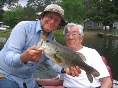 Dave and George C with a healthy bass caught and released on Benoit Lake, June, 2016.