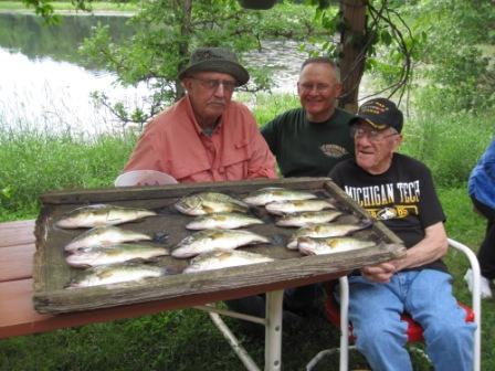 George N, Dave C., and my Dad, George C., with a mess of eater bass, Rainbow Bay Resort on Benoit Lake, June, 2018.