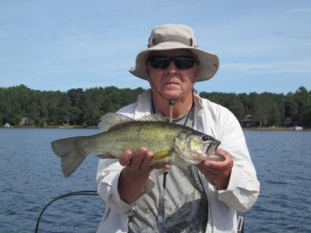 Dennis R. with a 17-inch bass that he caught and released, Burnett County Lake, June 2018.