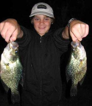 Jake K with a pair of black crappies he caught on Benoit Lake using tube jigs in about 14 feet of water.