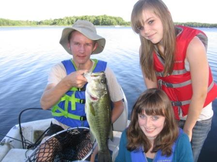 Jake C. caught and released this nice 20 inch bass on Benoit Lake on June 25.  Friends, Megan (seated) and Lora helped land the beauty.