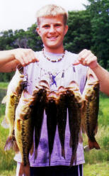 Joey R. with a nice stringer of eating bass caught on a nearby lake, 2004.
