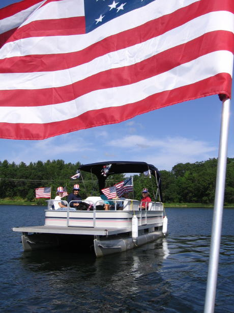 My neighbors in the fourth of July boat parade on our lake, 2006.