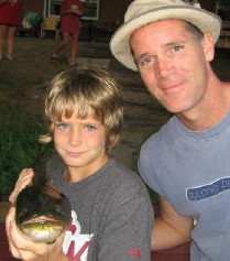Kyler and Gary T with a Benoit bowfin.  They are great to catch, especially for young anglers, summer 2006.