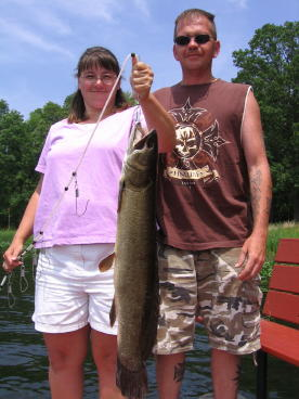 Lynn and Mike Helgeland with a nice bowfin she caught on our lake.  At the time, this was the record bowfin for our resort.