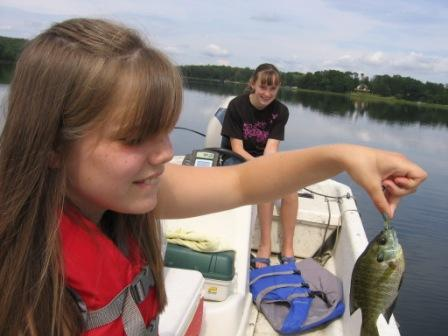 Lora G. with a bluegill Megan K. caught on Benoit Lake.  Apparently Megan was afraid to touch the fish.