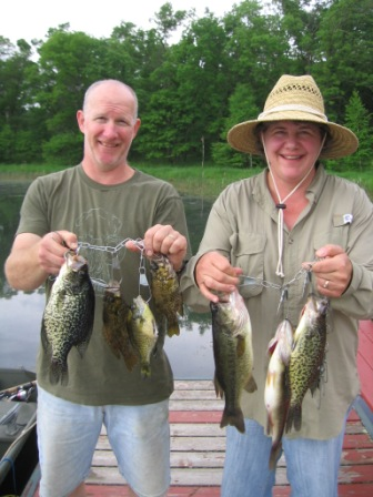 Mike and Tina D with a variety of nice eating fish, Benoit Lake, June 2013.