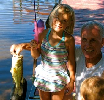 Molly M. caught and released this bass on our main dock in August, 2008.  Grandpa Bob was there to help handle the situation.  Photo courtesy of Dave Metcalf.