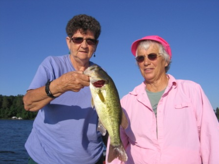 Rennie H. and Judy B. are all smiles after landing this nice bass one morning on Benoit Lake, July 2013.