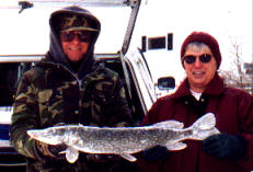 Dave and his friend, Judy, with a 28 inch pike from a nearby lake, December 2002.