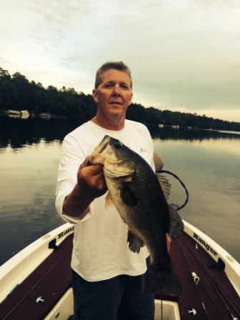 Mark C. with a nice bass he caught and released on a nearby lake, early-June 2015.